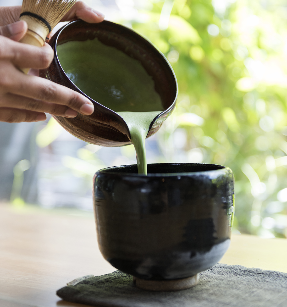Pouring Matcha into cup